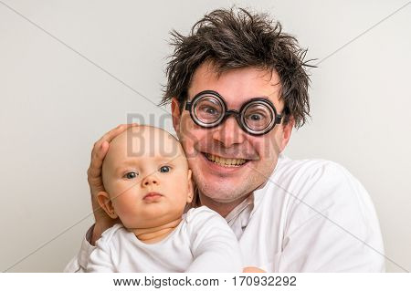 Crazy Doctor With Newborn Baby In His Hands