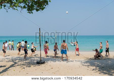 February 12, 2560 Thailand in Sattahip, Chonburi Sai Kaew Beach people relaxing by the ocean and beach activities such as volleyball.