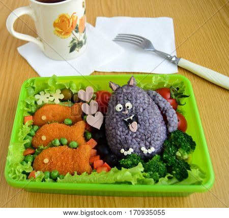 The cat is made of rice. Kyaraben, bento. Creative food for children.