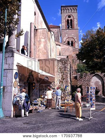 RAVELLO, ITALY - SEPTEMBER 23, 1996 - Tourist gift shop in the town square with a church tower to the rear Ravello Amalfi Coast Italy Europe, September 23, 1996.
