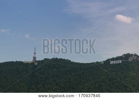 Brasov, Transylvania, Romania - September 22 2016 : Brasov sign and comunication tower on hill