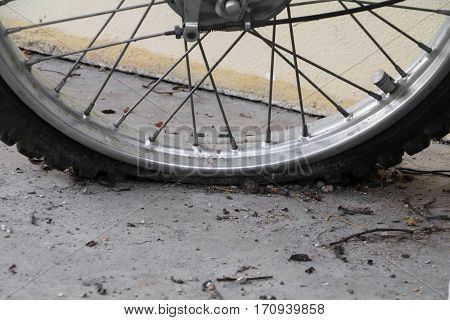 Close up wheel flat tire of the motorcycle old and cracked