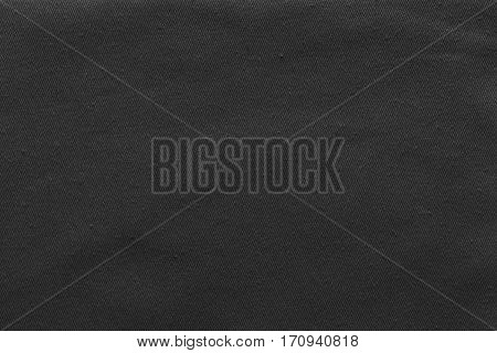 abstract background and texture of denim fabric or textile material of black color