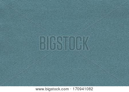 background and abstract grained texture of textile material or fabric of pale blue color