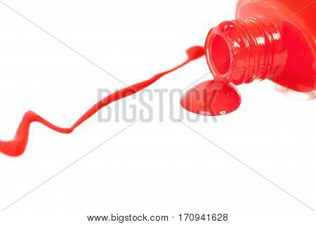 Red nail polish spilled. Isolated on a white background.