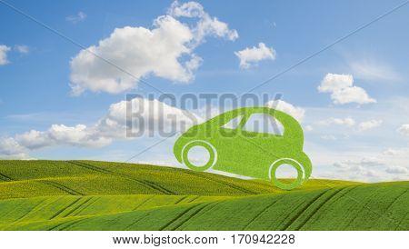 green ecological concept car,car on against a blue sky