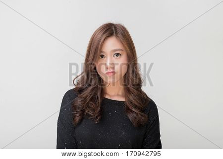 Pretty asian lady student making annoyed face