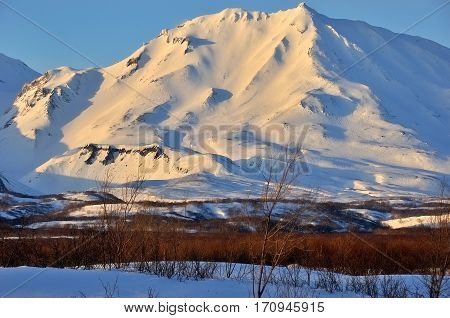Winter view of eruption active Klyuchevskoy Volcano. Russia