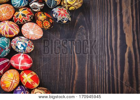 Easter eggs on a dark wooden background.