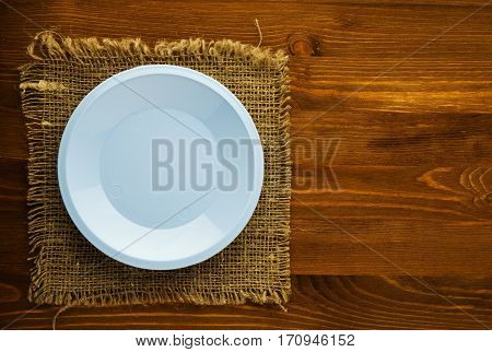 Plate On A Wooden Background. Plate Top View.blue Plate . Copy Space