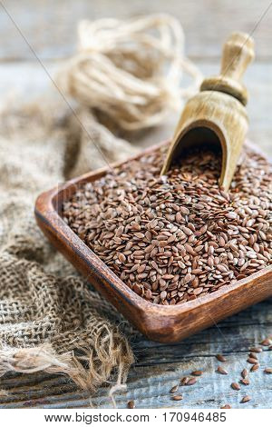 Seeds Brown Flax And Wooden Scoop.
