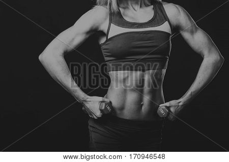 Black and white picture fitness girl on a black and white photo.