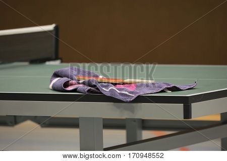 Table Tennis racket with towel on a Table Tennis Table