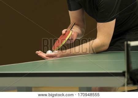 table tennis player serving, closeup