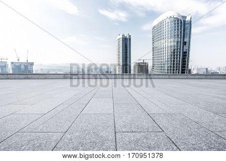 modern office buildings in hangzhou new city from empty brick floor