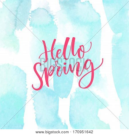 Hello Spring. Modern calligraphy text at blue watercolor texture. Inspirational saying. Spring season greetings