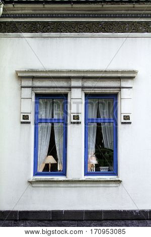 lampshade lit window exterior blue home house