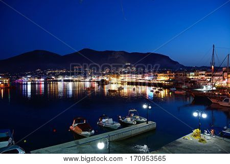 HERSONISSOS, CRETE - SEPTEMBER 18, 2016 - Elevated view of harbour and waterfront restaurants at dusk Hersonissos Crete Greece Europe, September 18, 2016.