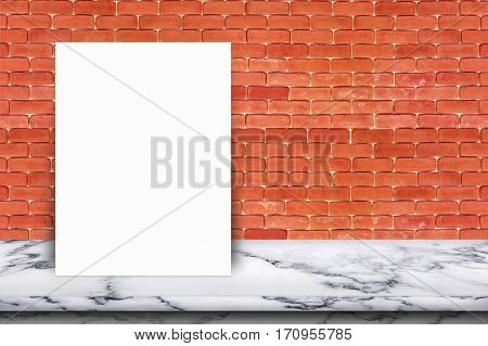 White paper poster lean on marble table with brick wall. For text input or according to your design.