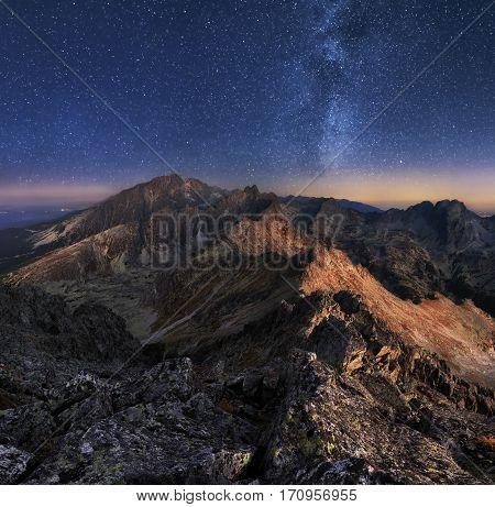 Mountain landscape with night sky and Mliky way Slovakia Tatras from peak Slavkovsky stit
