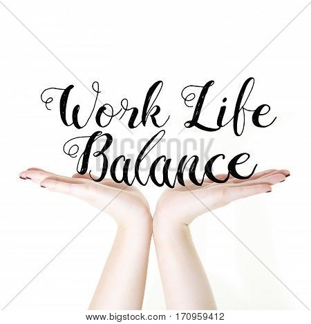 Hands holding the words Work Life Balance on a white background