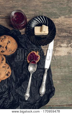 Spoon With Jam Near Chocolate Cookies And Biscuits On Wooden Table Background. Afternoon Break Time.