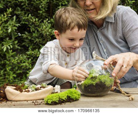 Grandma Kid Gardening Concept