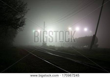 Railway in the mist, the gloomy fog