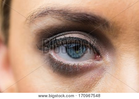Focus on eyes makeup with opened eyes in a studio