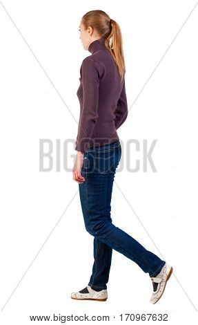back view of walking  woman  in  sweater . girl in white sandals are from left to right. beautiful blonde girl in motion.  backside view of person.