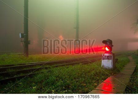 Semaphore on railway in the mist, the gloomy fog