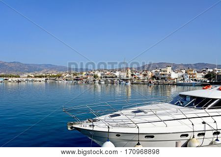 IERAPETRA, CRETE - SEPTEMBER 18, 2016 - View of the harbour with the town and mountains to the rear Ierapetra Crete Greece Europe, September 18, 2016.