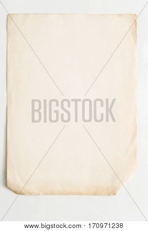 old craft wrapping paper isolated on white background. Aged brown kraft sheet with copy space