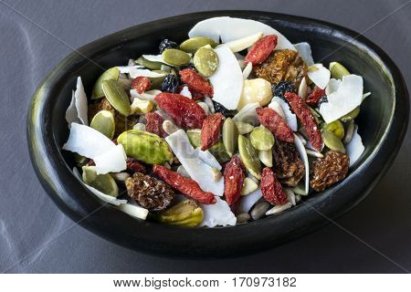 Raw organic paleo trail mix.  Includes seeds, nuts, inca berries, goji berries and coconut flakes.
