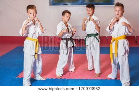 Children during training in karate. Fighting position active lifestyle practicing fighting techniques