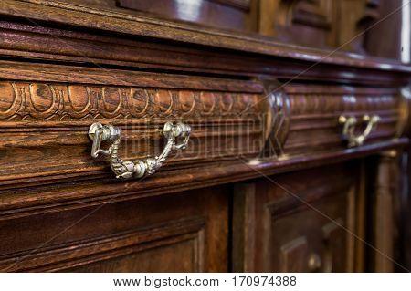antique wood dresser with vintage furniture. horizontal shot poster