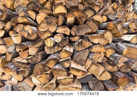 firewood stacked birch, oak, pine, ash. horizontal shot.
