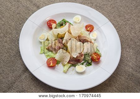 Caesar salad with croutons tomatoes bacon and chicken