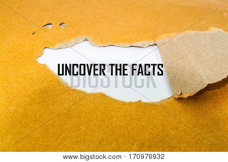 Uncover the facts concept on brown envelope