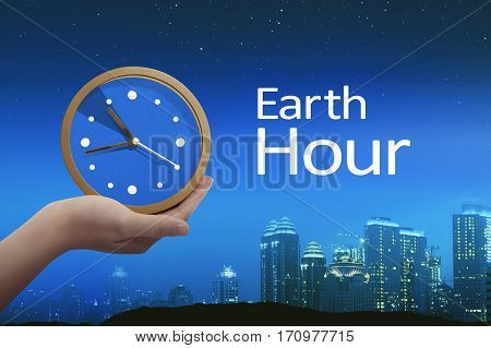 People Hand Holding Clock With Earth Hour Greeting