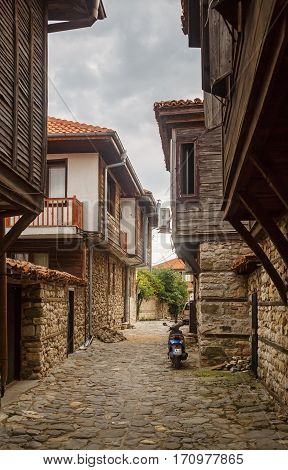 Nesebar Bulgaria - September 08 2014: Narrow street and ancient architecture in the old town of Nessebar Bulgaria. Nesebar is an ancient town on the Bulgarian Black Sea Coast. Vertical shot.