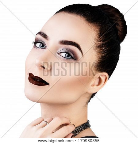 Portrait of beautiful woman with bright make-up isolated on white.