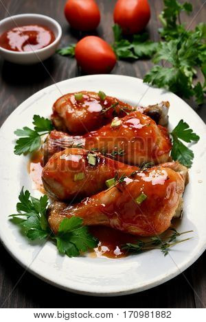 Roasted chicken drumsticks on plate dish for dinner