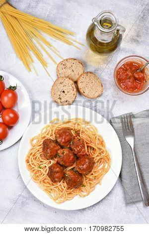 Spaghetti pasta with meatballs and tomato sauce top view