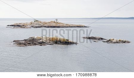 Three tiny islands in the baltic sea in the swedish archipelago