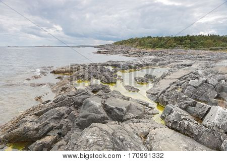 Dramatic threatening rocky coastline dark clouds and sea in the swedish archipelago