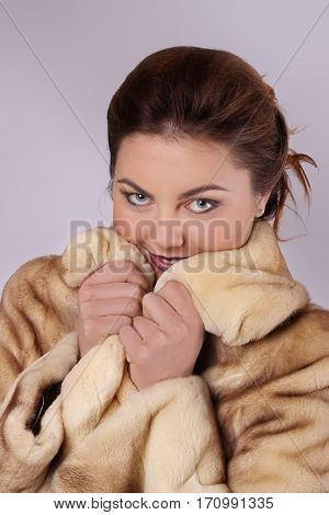Young Sexy Brunette Girl With Gray Eyes In A Mink Coat