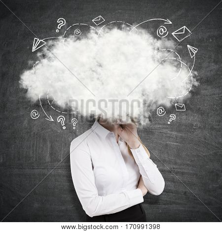 Side view of young businesswoman with head in the clouds on chalkboard background. Daydreaming concept