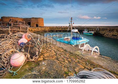 Beadnell Harbour Fishing Gear, at Beadnell village on the Northumberland coastline, which is a small fishing harbour set into Beadnell Bay. Disused medieval Lime Kilns sit in the harbour