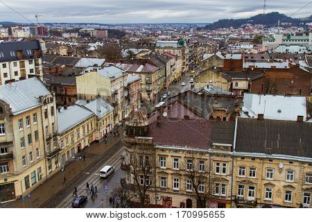 Old Lviv in Ukraine. The view from the city hall of the city and the mountain High castle. February 2016